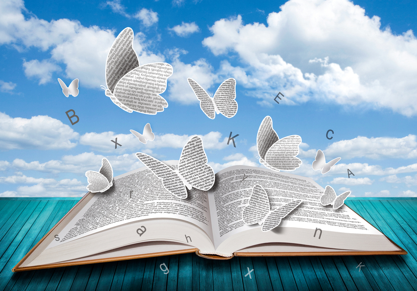 Open book with butterflies letters on blue sky